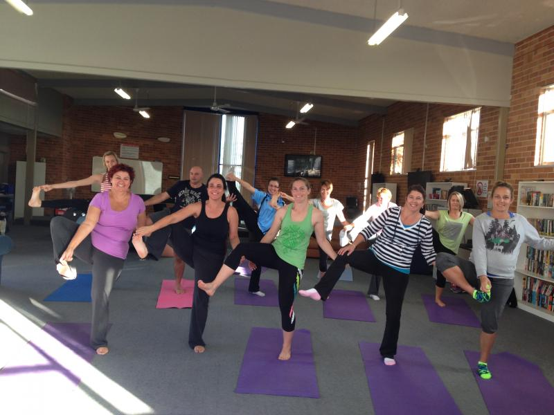 Teachers of St Agnes Primary Port Macquarie in a group yoga pose for Retreat Day