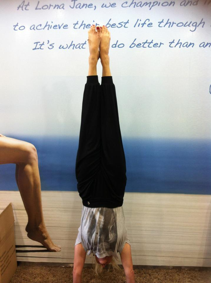 Martine Ford of Spirit Yoga practicing a handstand at Lorna Jane
