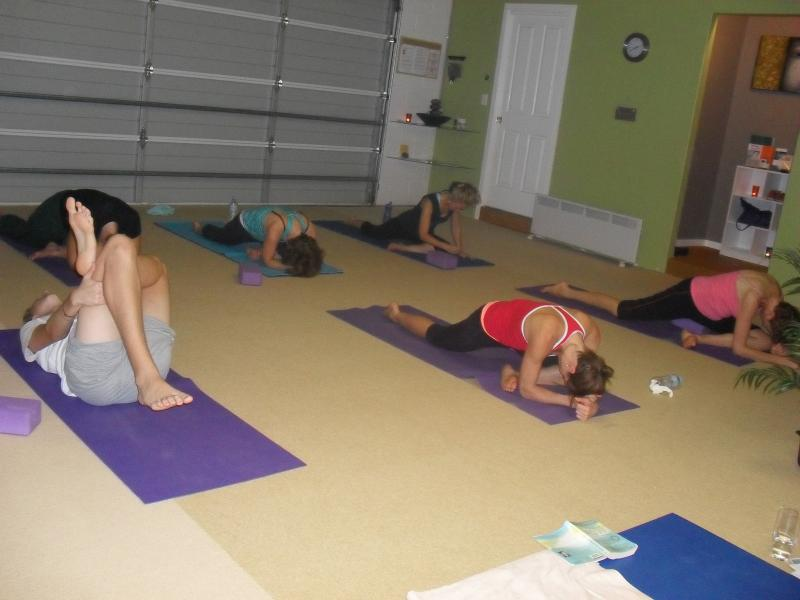 Image of people practicing autumn yoga poses