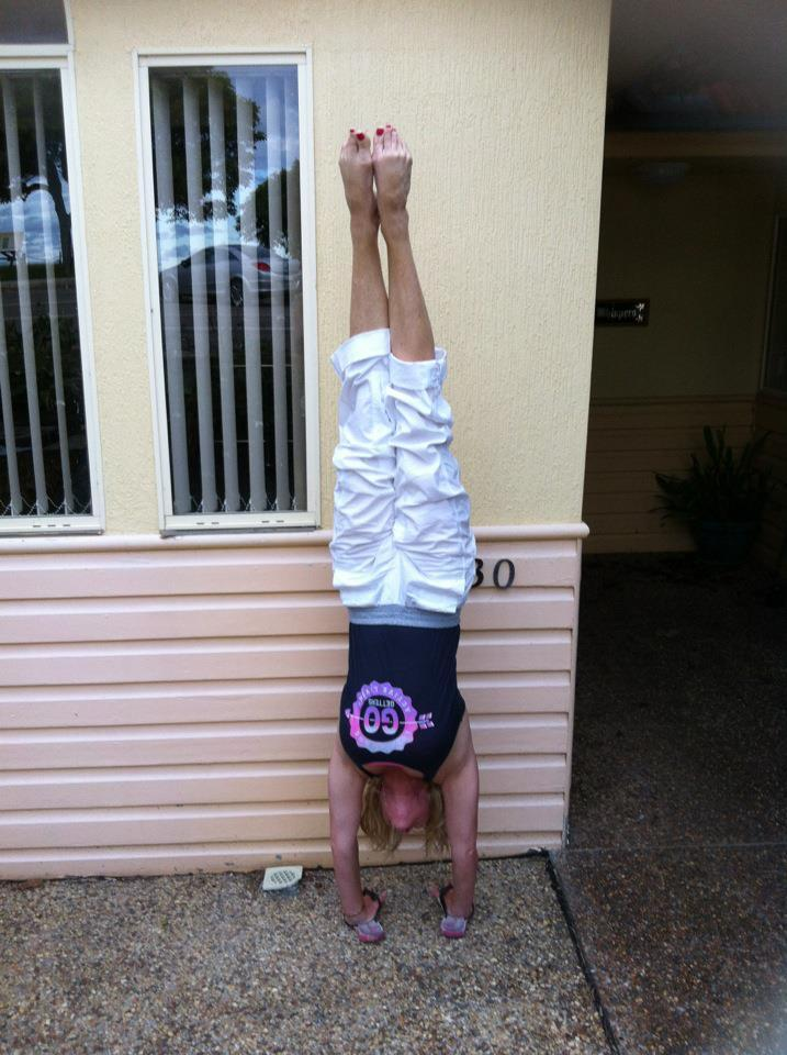 Martine Ford of Spirit Yoga practicing a handstand with hands in thongs
