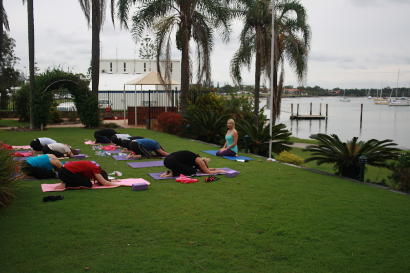 Ladies practicing yoga on the banks of the river for the 'Me Time' Event