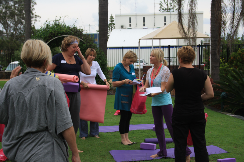 Ladies finishing yoga and checking out their Lorna Jane gift bags