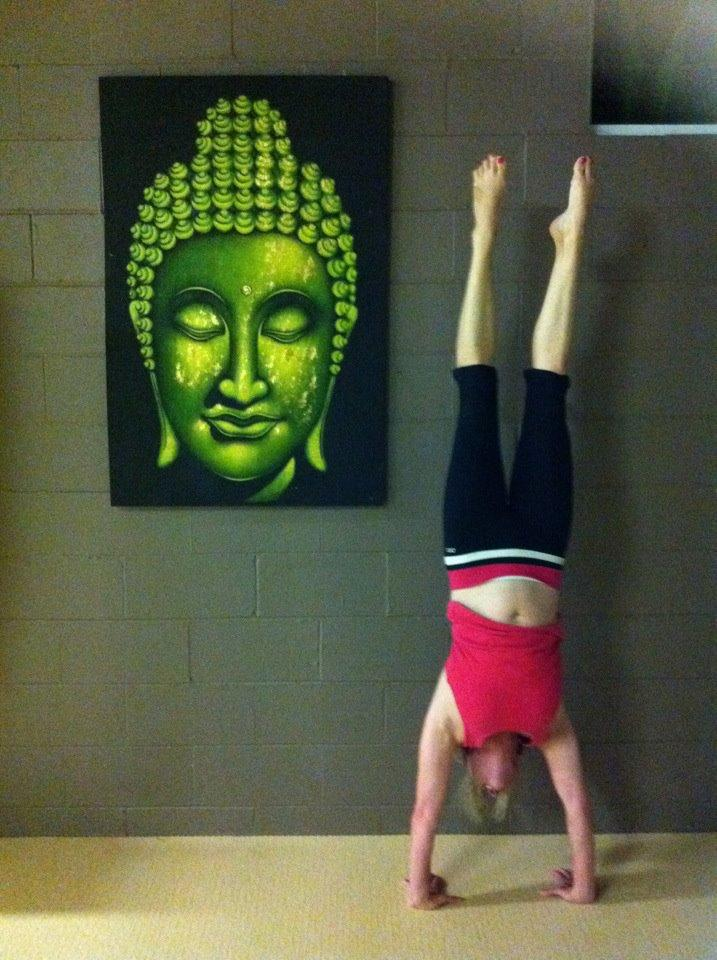 Martine Ford of Spirit Yoga practicing a handstand in the studio