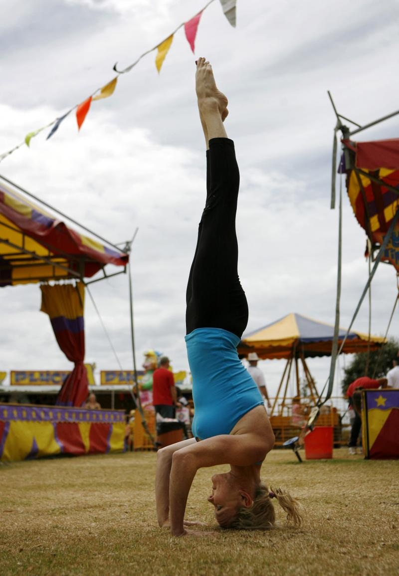 Martine Ford of Spirit Yoga in Tripod Headstand at the Circus.