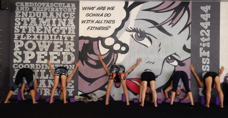 students against the wall upside down in Wall Bull Pose