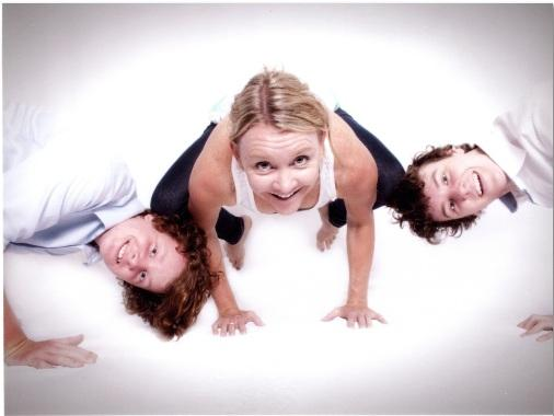 Martine Ford of Spirit Yoga in Bakasana with her boys, Trent and Oscar