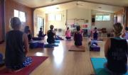 students sitting on yoga mats for a Yin Class at Yin/Yang Retreat by Yoga Shala