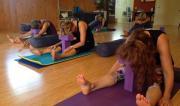 Students in Caterpillar (Yin) Pose at a Yin/Yang Retreat by Yoga Shala.