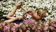 Martine Ford of Spirit Yoga in Gherandasana Pose amongst flowers