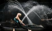 Martine Ford of Spirit Yoga in front of a fountain in a lunge